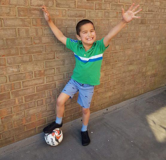 Boy in Junior Freet Flex with football
